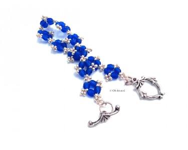 """Bracelet """"Poinsettia"""" de couleur saphir et argenté"""